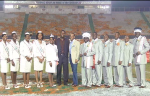 Kris Gibson (cream blazer) with the 2009-2010 FAMU DRS Royal Court and Advisor, Roger Walker