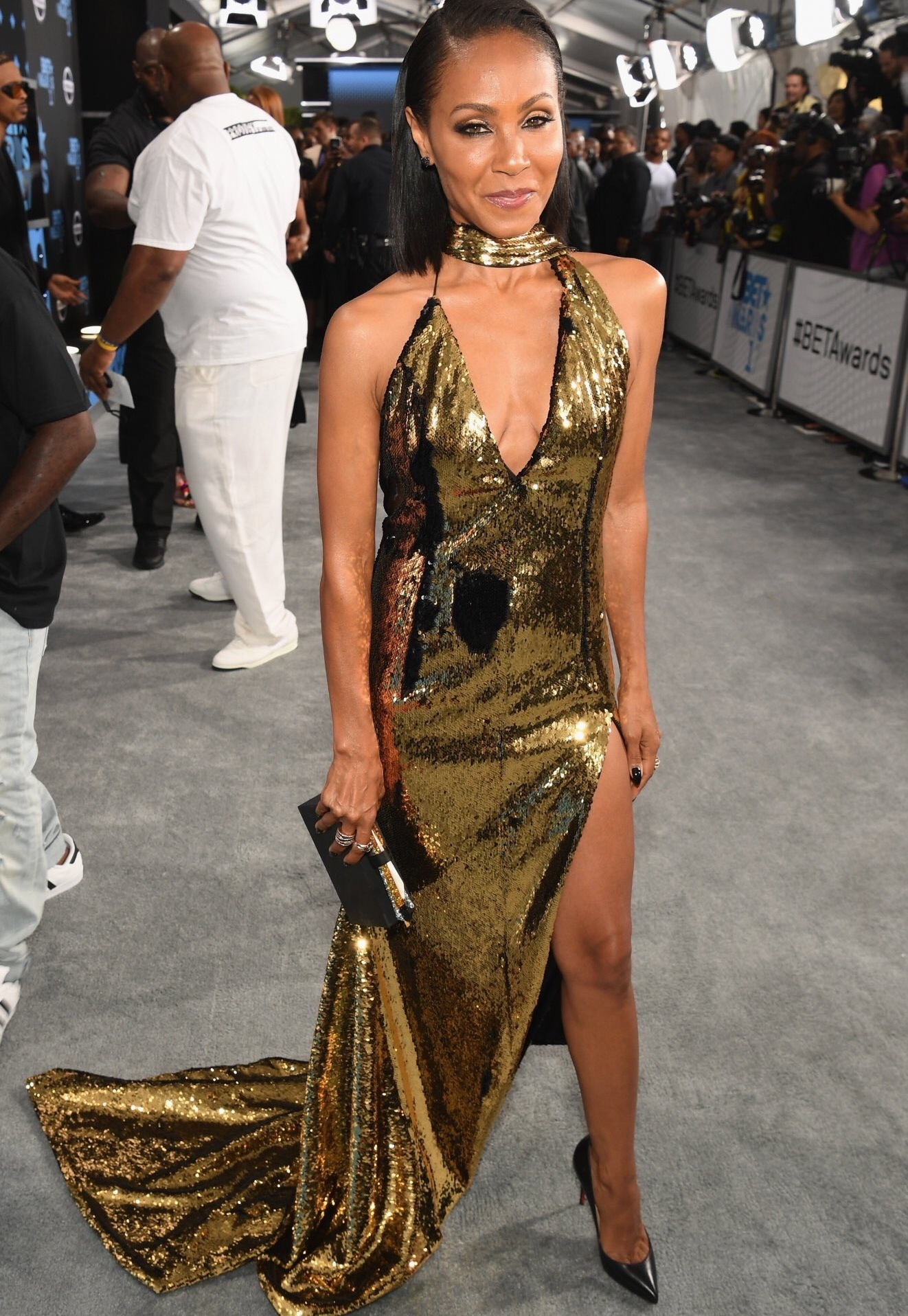 Jada Pinkett Smith, showcased her spectacular body in a golden sequin number.
