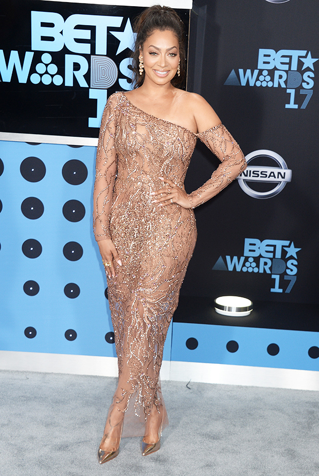 Lala Anthony celebrated her birthday while walking the BET carpet and she looked great! Glowing and showing her picturesque physique, she dawned a neutral see-through dress.
